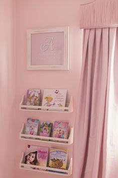 Book shelves in a pink nursery - so sweet!