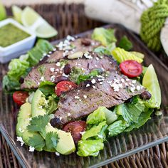 Warm, Grilled Steak Salad with Cool Greens, Avocado, Black Beans and Crumbled Cotija with Cilantro-Lime Vinaigrette