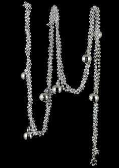 6ft Silver Bead Garland with Silver Balls  in a flat serving bowl with lots of candels in different sizes, hgtv dec, p. 136