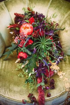 A lush, trailing bouquet is ideal for a bohemian wedding | @veronicavaros | Brides.com