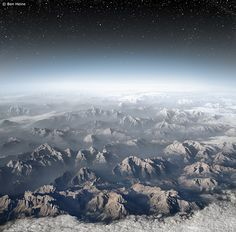 Planet Earth by Ben Heine, via Flickr    Taken from a plane flying over the Swiss Alps.