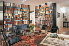 "Architect David Ling renovated an Upper East Side apartment for a bibliophile neurosurgeon and incorporated a rare-book library—which Ling described as ""the centerpiece of the design""—to the mix. Medical books, some dating to the 15th century, line the modern shelves. The sitting area features a Mies van der Rohe Barcelona table surrounded by a Le Corbusier love seat and sling-back chairs."