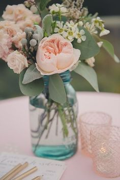 Peach and blush flowers filled in mason jar wedding centerpieces. Here're some creative ways you can utilize the mason jar wedding centerpieces Wedding Table Flowers, Wedding Bouquets, Bridal Shower Flowers, Table Centre Pieces Wedding, Wedding Dresses, Cascading Bouquets, Purple Bouquets, Pink Bouquet, Brooch Bouquets