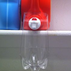 I modified the soda bottle drip catcher to fit my detergent dispenser. No more messy cabinets or machine tops! Laundry Craft Rooms, Laundry Nook, Laundry Room Wall Decor, Laundry Hacks, Laundry Basket Holder, Diy Organisation, Room Organization, Organizing, Liquid Laundry Detergent