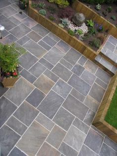 GALAXY NATURAL SANDSTONE PAVING Great pattern and colour. Also like vertical timber edging.