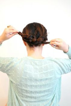 The Easiest Braided Updo You'll Ever Try Pull the two strands tight, creating a knot with your hair.