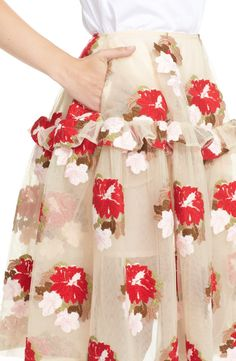Love this delightfully full A-line tulle skirt adorned with with gorgeous embroidered flowers.