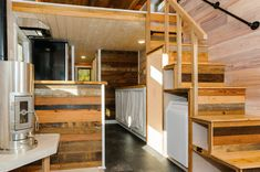 """A full staircase, with railing. The """"MH"""". 10' x 24' custom tiny home on wheels - Wishbone Tiny Homes"""