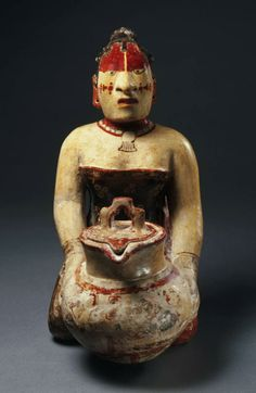 Late Classic, Maya. Kneeling noble woman holding a lidded jar, A.D. 650–750.              Ceramic with polychrome.