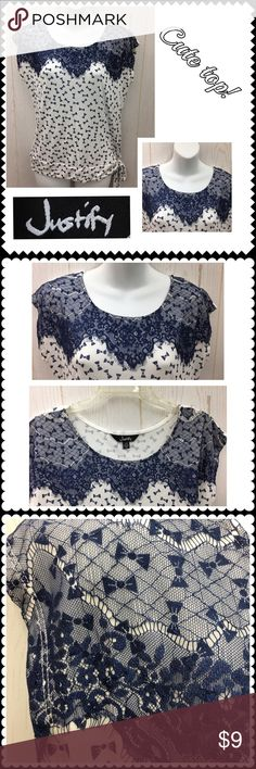 Juniors Bow print shirt by JUSTIFY. Sz Large Cute shirt by JUSTIFY. All over blue bow print. Lace trim on shoulders. Ties at left hip. Sz Large Justify Tops Tees - Short Sleeve