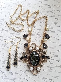 Check out this necklace set in my Etsy shop https://www.etsy.com/listing/591362055/victorian-style-mother-of-pearl-necklace