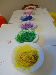 a fun sensory experience - spaghetti with tempera paint, on construction paper; start with a few for making letters, then let them go wild with a bunch