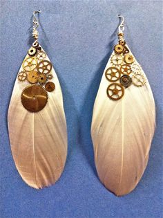 hippy meets steampunk white feather earrings with watch parts! $25.00 on etsy love these!