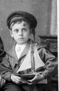 Victorian photo sailor boy with a sailboat