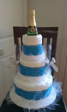 Wedding towel cake with sparkling juice and champagne glasses.
