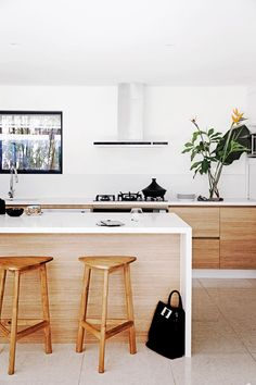 """While the kitchen is brand new, it was built in the same location as the previous one. """"We needed more cupboard and bench space but importantly the kitchen is the centre of our home,"""" Kelli says. Timber Kitchen, Rustic Kitchen Cabinets, Wooden Kitchen, Beach House Kitchens, Home Kitchens, Modern Kitchens, Dream Kitchens, Real Living Magazine, Kitchen Island Bench"""
