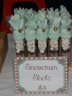 Snowman shots- tubes of hot cocoa decorated like a snowman