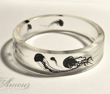 float on - clear resin bangle featuring little jellyfish silhouettes. picture on VisualizeUs