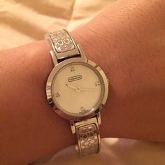 Coach Bangle Watch Bracelet Authentic. Stainless steel. Water resistant. Adjustable band with links. Comfortable and easy to wear. Swiss Quartz. Diamonds on face. CC design on band. Does not come with original box. Coach Accessories Watches