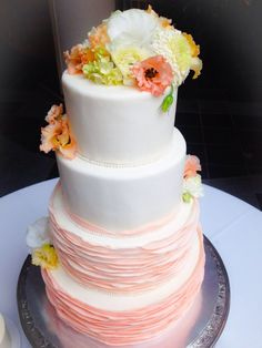 Ombré peach smooth ruffle four tier wedding cake with sugar and real flowers