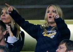 50d14f32c Carrie Underwood Photos - Country music singer Carrie Underwood celebrates  after a goal by the Nashville Predators against the Vancouver Canucks on  February ...