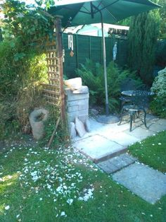 My outdoor sculpture studio. Complete with rose petals on the ground!