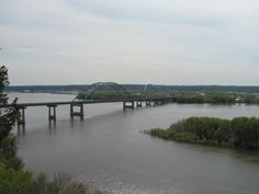 Dubuque–Wisconsin Bridge     The Dubuque–Wisconsin Bridge is a steel tied arch bridge connecting Dubuque, Iowa, with still largely rural Grant County, Wisconsin. It is an automobile bridge that traverses the Mississippi River. Wikipedia      Dubuque Wisconsin Bridge.. Total length: 2,951' (900 m) Clearance below: 66' (20 m) Location: Dubuque Bridge type: Tied-arch bridge Body of water: Mississippi River
