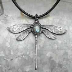 chased wings, sea glass body