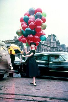 """Throw in a dash of Sartre, some bongos, the fashions of Givenchy, location shooting in Paris, and a pas de deux in white tulle to George and Ira Gershwin's ""He Loves and She Loves,"" and, well, we love."" -Vanity Fair, Funny Face 1957"