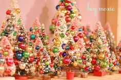swoon, swoon, swoon!     The sight of bottle brush trees all gussied up in their brightly colored glass ornaments makes me all gidd...