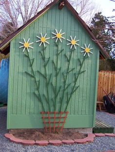 Great trellis idea - looks cute even when not covered in flowers/vines.
