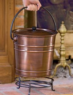 This Metal Bucket Safely Contains Ashes in Style