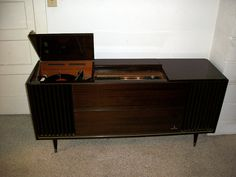 Once I own/settle into a home, I'd like to have one of these.  Just a classic, awesome piece.    ~1966 Grundig Multi-Stereo Console by BigBlackLincoln, via Flickr