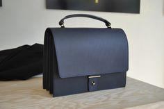 designer Handbag on display inside parisian fashion new comer concept-store in the 3rd Arrondissement - The Broken Arm