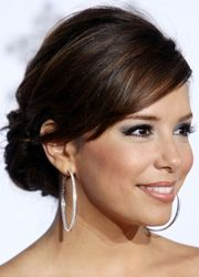 eva longoria neat low bun updo hairstyle with side bangs