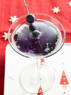 Old Blue Eyes Martini (1 cup ice cubes  5 oz cranberry juice  2 oz Pearl Blueberry Vodka   1 oz Blue Curacao   1/2 oz Simple Syrup   1/2 oz lime juice   Blueberries)