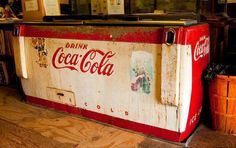 Reachin' down into one of these ice chests for a frosty cold soda in a glass bottle.