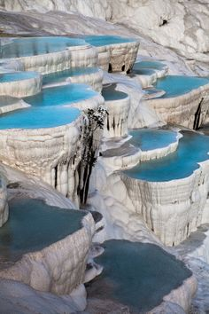 """Pamukkale, Turkey amukkale, meaning """"cotton castle"""" in Turkish, is a natural site in Denizli Province in southwestern Turkey. The site contains hot springs and travertines, terraces of carbonate minerals left by the flowing water. It is located in Turkey's Inner Aegean region, in the River Menderes valley, which has a temperate climate for most of the year."""