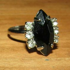 Black Stone with Sparkles $$OBO$$ Band is adjustable.   CLOSET CLEAR OUT! Taking all offers as long as they are made using the button! Also bundling for a bargain with 20% off 2 or more! Jewelry Rings