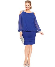 Betsy & Adam's elegant plus size blouson dress boasts glam appeal, thanks to split chiffon sleeves with sparkling rhinestones at the shoulders and cuffs. | Polyester; combo: polyester/spandex; lining: