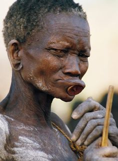 """Bodi Woman, Ethiopia  """"The weathered face of a Bodi woman reflects hardships endured and years survived in southwest Ethiopia."""""""