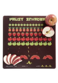Cute cutting board. Everyone should want to be invaded by fruit!