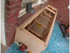 DIY storage bench.. I want this for outside my front door so guests can have a place to remove & store their shoes.