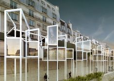 """MenoMenoPiu Architects says its concept to reinvigorate the Seine with a string of capsule homes on stilts could help prevent Paris from becoming a """"city museum""""."""