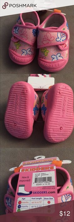 Baby skidders pink sneakers sz4 (12mo) Baby skidders sneakers size 4 (12months). Pink in color with butterfly pattern). Extra grip bottom to prevent falling. Skidders Shoes Sneakers