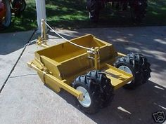 Soilmover scraper that I built, almost identical to originals, took the liberty of adding dual rear wheels Compact Tractor Attachments, Garden Tractor Attachments, Atv Attachments, Small Garden Tractor, Garden Tractor Pulling, Small Tractors, Compact Tractors, Lawn Mower Tractor, Lawn Tractors