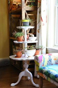 And this tiered stand. Love. Found it at a junk market, and have used it to hold plants ever since. Oh look, there's Mati's settee!