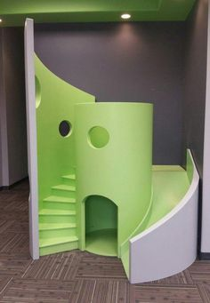 Here is our funky, modern, waiting room playhouse in green. Playhouse With Slide, Kids Playhouse Plans, Kids Indoor Playhouse, Backyard Playhouse, Build A Playhouse, Indoor Playground, Modern Playhouse, Office Waiting Rooms, Dental Office Design