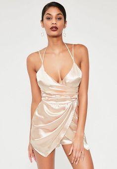 Ultra-luxe slip on pieces are on trend RN, and this silky little number will make sure you've got your best bedroom eyes on - featuring a champagne nude hue, silky satin, asymmetric cut, cami straps and a ruched style.