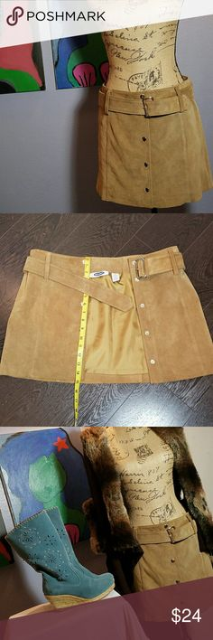 Suede mini skirt leather Old Navy Super classy camel colored suede mini skirt with belt. Approximately 15 inches long, sits low on the waistline. 5 snap buttons. Fully lined. Cute with boots, snug fitted sweater, tank top, tee's. Very versatile. EUC Old Navy Skirts Mini
